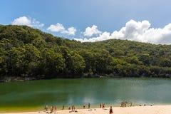 People enjoying Lake Wabby in Fraser Island, Queensland, Australia stock photo