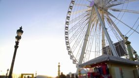 People enjoying leisure in crowded theme park, huge observation wheel rotating. Stock footage stock video