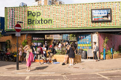 People enjoying the London summer in a new pop-up opened in Brixton Royalty Free Stock Photos