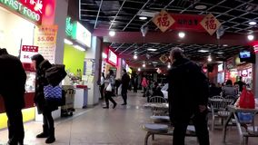 People enjoying meal at food court stock footage