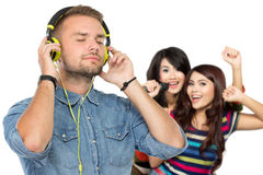People enjoying music with headphones Royalty Free Stock Images