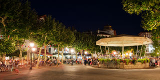 People enjoying music on Place Louis XIV at night, in St Saint de Luz Stock Image