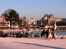 People enjoying a nice day around Louvre, Paris. People enjoying a nice summer day around Louvre Museum, Paris, France, Europe.  Arc de Triomphe du Carrousel Stock Image