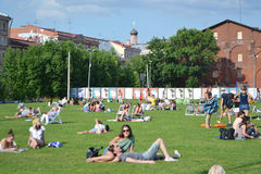 People enjoying relaxing outdoors on the lawn stock photo