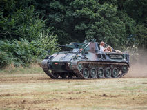 People Enjoying a Ride in an Armoured Car at Dunsfold Airfield Royalty Free Stock Image