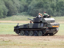 People Enjoying a Ride in an Armoured Car at Dunsfold Airfield Stock Photography