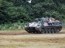 People Enjoying a Ride in an Armoured Car at Dunsfold Airfield Royalty Free Stock Photo