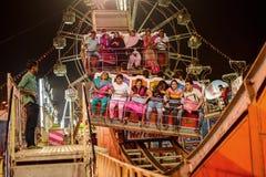 People enjoying ride on Ferris wheel at night. Royalty Free Stock Photo