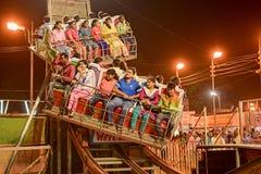 People enjoying ride on Ferris wheel at night. Royalty Free Stock Images