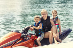 People enjoying a ride on a personal watercraft royalty free stock photos