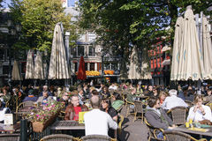 People enjoying s sunny day in Amsterdam Royalty Free Stock Images