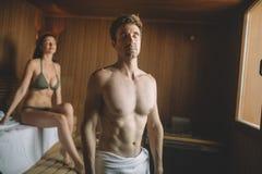 People enjoying sauna health benefits and relax royalty free stock image