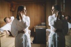 People enjoying sauna health benefits in spa stock photo