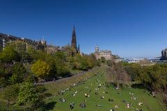 People enjoying the spring sun in Edinburgh`s Princess Street Gardens. EDINBURGH, UK - May 6, 2017: People enjoying the spring sun in Edinburgh`s Princess Stock Photography