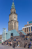 People enjoying the spring sun in front of the Martini tower Royalty Free Stock Image