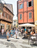 People enjoying a street bar in historic center of Como, Italy Royalty Free Stock Images