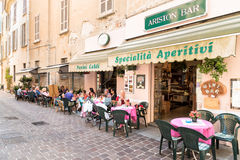 People enjoying a street wine bar in historic center of Como, Italy Stock Image