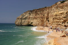 People enjoying the summer. At the beach (coastline of Carvoeiro-Algarve-Portugal Stock Image