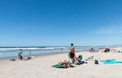 People enjoying a summer day at beach. Royalty Free Stock Images