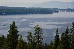 People Enjoying Summer Lake in the Mountains Stock Image