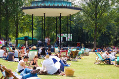 People enjoying the summer at Regent Park. In London.Designed by architect John Nash and opened in 1845,the park is a favourite destination for tourists and Stock Images