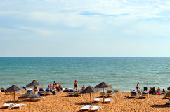 People enjoying the sun on Albufeira Beach Royalty Free Stock Images