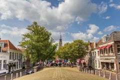 People enjoying the sun at the central square of Edam royalty free stock image