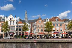 People enjoying the sun at a historic canal in Haarlem Stock Photography