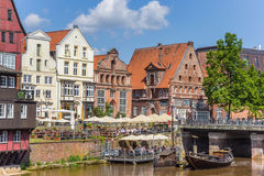 People enjoying the sun in the historic harbor of Luneburg Royalty Free Stock Photos