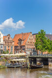 People enjoying the sun in the historic harbor of Luneburg Royalty Free Stock Photography