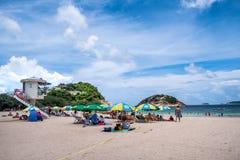 People enjoying sun shine at beach at sunny afternoon stock image