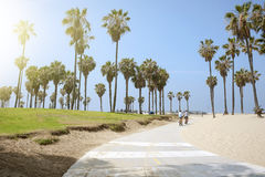 People enjoying a sunny day on the beach of Venice, California Stock Image