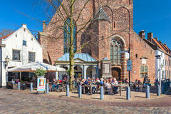 People enjoying a sunny spring day on a Dutch terrace Royalty Free Stock Photos