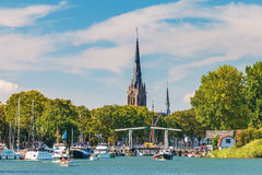 People enjoying a sunny summer day on the river Vecht in front o Stock Photo