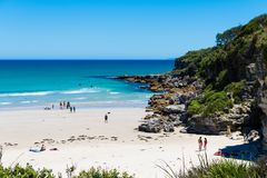 People enjoying the sunny weather at Cave beach in Jervis Bay, Booderee National Park, NSW, Australia