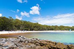 People enjoying the sunny weather at Galamban Green Patch beach in Jervis Bay, Booderee National Park, NSW, Australia stock photography