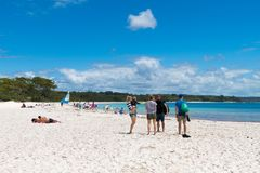 People enjoying the sunny weather at Galamban Green Patch beach in Jervis Bay, Booderee National Park, NSW, Australia stock images