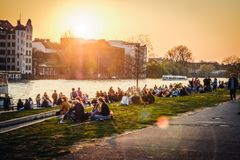 Free People Enjoying Sunset At River Next To The Berlin Wall / East Side Gallery  In Berlin, Germany Stock Image - 144230611
