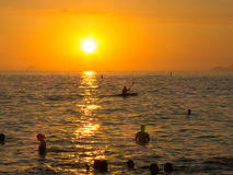 People enjoying the sunset on the beach in Rio de Janeiro royalty free stock image