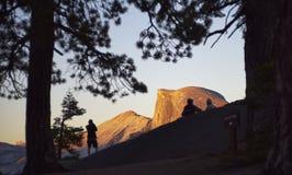 People enjoying sunset at Half Dome, Yosemite Stock Image