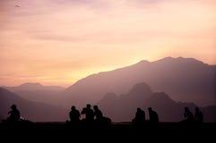 People enjoying sunset Stock Images