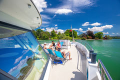 People enjoying the Swiss landscape view from famous boat at Lake Zug, Switzerland Stock Photography