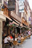 People relax and enjoy at a cosy terrace in London Court, Perth, Australasian