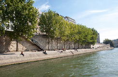 People are enjoying their free time on the banks of river Seine, in Paris Stock Image