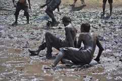 People enjoying themselves in the mud on Ozora Fes Stock Photos
