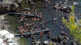 People Enjoying Thermal Springs of Sorgeto Bay