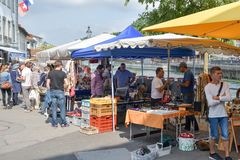People enjoying traditional market in Luzern, Switzerland on sunny Saturday royalty free stock image