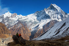 People enjoying view of Machhapuchchhre mountain - Fish Tail in Stock Image