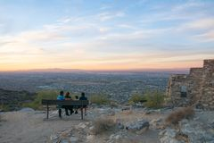 People enjoying the view over Arizona phoenix downtown from the mountains at sunset, usa, panorama stock photos