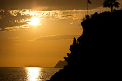 People enjoying the view of the sunset from Manarola, Cinque Ter Stock Photos